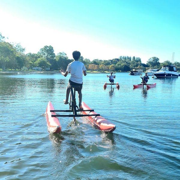three people enjoying waterbike hire on the swan river in perth